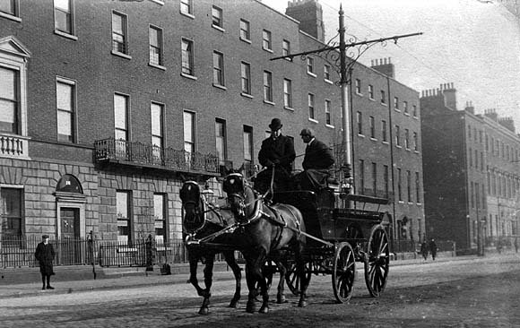 549183f15f5 A horse-drawn carriage passes through Merrion Square c.1900. Merrion Square  is one of Dublin s grandest Georgian Square (NLI